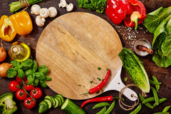 Cutting Board, Fresh Vegetables And Herbs On Table Stock Image