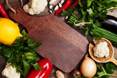 Cutting board and fresh vegetables (Top view ) Stock Image
