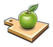 Cutting board with green apple Royalty Free Stock Photography