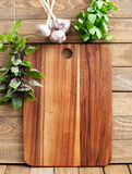 Cutting board with herbs Royalty Free Stock Images