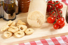 Cutting board with italian culinary specialities Stock Photo