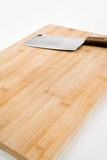 Cutting Board and Kitchen Knife Stock Photo