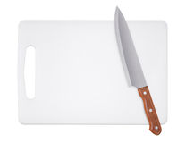 Cutting board and kitchen knife Royalty Free Stock Photos