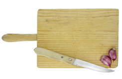 Cutting board with knife and garlics. Wooden cutting board with knife, garlics, and text space on top, isolated with white background Stock Photo
