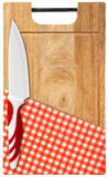 Cutting Board with Knife and Tablecloth Stock Photos