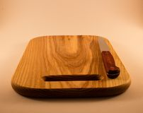 Cutting board and knife Stock Images