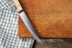 Cutting board with a knife Royalty Free Stock Photos