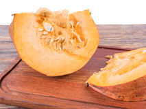 Cutting board with lying on her pumpkin royalty free stock photos