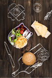 Cutting board lying near salad bowl Royalty Free Stock Images