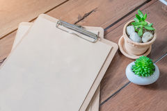 Cutting board with menu sheet of paper on rustic wooden planks b. Ackground.top view Royalty Free Stock Photo