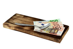 Cutting board and money Stock Photography