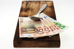 Cutting board and money. Stock Photo