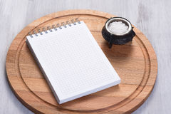Cutting board and notepad Stock Photo