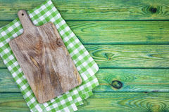 Cutting board over green checkered tablecloth, top view Stock Photography