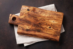 Cutting board over towel on stone kitchen table royalty free stock photos