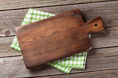 Cutting board. Over towel on wooden kitchen table. Top view Stock Image
