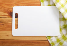 cutting board over towel on wooden kitchen table top view stock photo. Interior Design Ideas. Home Design Ideas