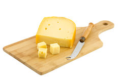 Cutting board and piece of Dutch cheese Royalty Free Stock Photography