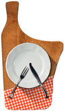 Cutting Board with Plate and Cutlery Royalty Free Stock Images