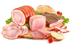 Cutting board with pork, bacon, ham and bread Royalty Free Stock Photo