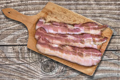 Cutting Board With Pork Belly Rashers On Old Wooden Background Stock Photography