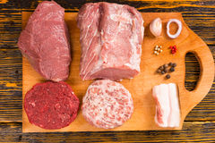 Cutting board with raw meat pieces Royalty Free Stock Photo