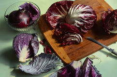 Cutting board, red cabbage, red radicchi Stock Photography