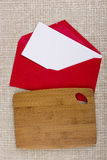 Cutting board and red paper envelope Stock Photos