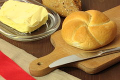 Cutting board with a roll. Breakfast Royalty Free Stock Images