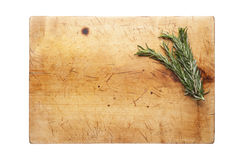 Cutting board with rosemary. Wooden cutting board with rosemary Stock Images