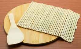 Cutting board and scoop on a wooden table royalty free stock photography