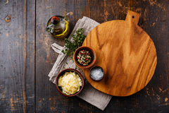 Cutting board, seasonings and parmesan cheese Stock Image