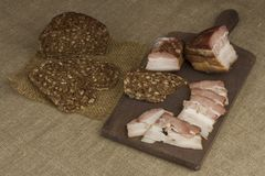 Cutting board with smoked bacon and bread. Raw bacon Stock Photo