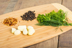 Cutting board with spices for cooking Royalty Free Stock Photos