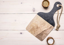 Cutting board with spices on a wooden table accessories for cooking wooden rustic background top view Stock Images