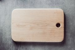Cutting board at table Royalty Free Stock Images