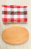Cutting board with tablecloth Royalty Free Stock Images