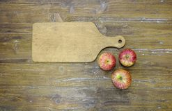 Cutting board with three apples. Royalty Free Stock Photography