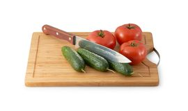 Cutting Board  with three tomatoes Stock Photography