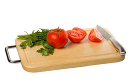 Cutting board with tomato. Isolated on white background Royalty Free Stock Photography