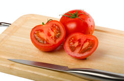 Cutting board with tomatoes. Isolated on white background Royalty Free Stock Photo