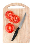 Cutting board with tomatoes and knife Royalty Free Stock Photography