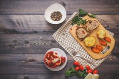 A large piece of baked meat Still life on a light wooden table stock photos