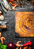 Cutting Board with a variety of shrimp, fish and shellfish. Royalty Free Stock Photo