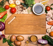 Cutting board, vegetables, herbs and spices. Colorful ingredient Royalty Free Stock Photos