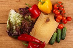 Cutting board and vegetables Stock Photo