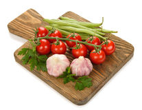 Cutting board and vegetables Stock Image