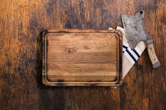 Cutting Board with vintage butcher knife and cloth napkin Stock Image