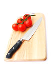 Cutting Board With A Knife And Tomato Royalty Free Stock Photo