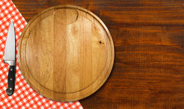 Cutting Board on Wood Table Stock Image